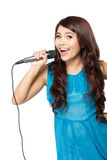 Young woman sing holding a mic, isolated Stock Photos