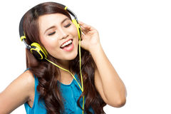 Young  woman sing while listening to music with headphone, isola Stock Photos