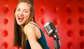 Young woman singer. Retro style stock photography