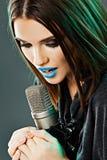 Young woman singer. Karaoke. Beauty model royalty free stock image