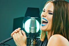 Young woman singer. Karaoke. Beauty model stock photo