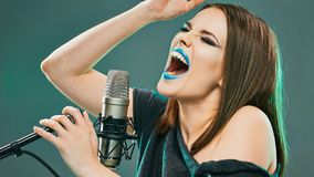 Young woman singer. Karaoke. Beauty model stock photography