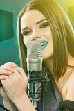 Young woman singer. Karaoke Stock Photography