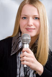 Young woman singing Royalty Free Stock Images