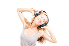 Young woman singing with headphones Royalty Free Stock Images