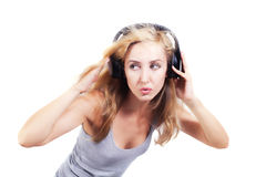 Young woman singing with headphones isolated Stock Photo