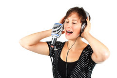 Young woman singing with headset and microphone Royalty Free Stock Photography