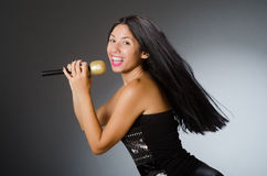 The young woman singing in karaoke club Royalty Free Stock Photos