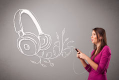 Young woman singing and listening to music with abstract headpho Stock Photos