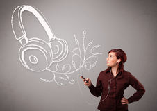 Young woman singing and listening to music with abstract headpho Royalty Free Stock Image