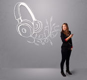 Young woman singing and listening to music with abstract headpho Stock Images