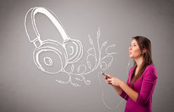 Young woman singing and listening to music with abstract headpho. Ne getting out of her mouth Royalty Free Stock Image