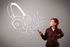 Young woman singing and listening to music with abstract headpho. Ne getting out of her mouth Royalty Free Stock Photos