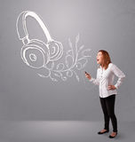 Young woman singing and listening to music with abstract headpho. Ne getting out of her mouth Stock Image