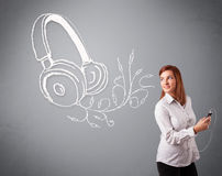 Young woman singing and listening to music with abstract headpho Royalty Free Stock Photos