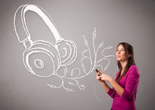 Young woman singing and listening to music with abstract headpho Royalty Free Stock Photography