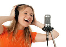 Young woman singing with the microphone royalty free stock images