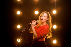 Young woman singing song on the stage in karaoke Royalty Free Stock Photos