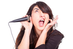 Young woman singing in studio royalty free stock photography