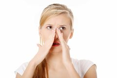 Young woman with sinus pressure pain Stock Image