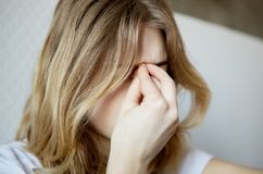 Young woman with sinus. Royalty Free Stock Images