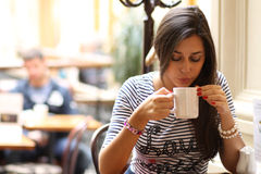 Young woman sipping coffee Royalty Free Stock Photos