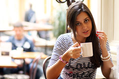 Young woman sipping coffee Stock Photo