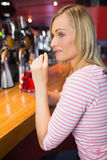 Young woman sipping drink at bar counter Royalty Free Stock Photo