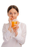 Young woman sipping juice with a straw Royalty Free Stock Photography