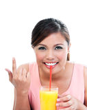 Young Woman Sipping Orange Juice Royalty Free Stock Photo