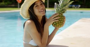 Young woman sipping a pineapple cocktail stock footage