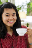 Young woman sipping tea from a cup Royalty Free Stock Photo