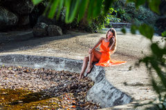 Young woman sirring in the tropical park Royalty Free Stock Images