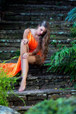 Young woman sirring in the tropical park Royalty Free Stock Photos