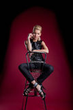 Young woman sit bar chair rock leather jacket Stock Images