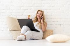 Young Woman Sit On Floor Using Laptop Computer Hold Credit Card Phone Call, Beautiful Girl Shopping Online Royalty Free Stock Image