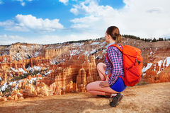 Young woman sit on squads in Bryce canyon Stock Image