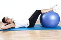 Young Woman Sit Up With Ball Stock Photography