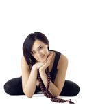 Young woman sit in yoga asana with beads Stock Photography