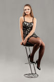Young woman sits on bar chair Royalty Free Stock Photos