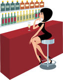 Young woman sits at a bar counter Royalty Free Stock Image