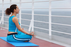 Young woman sits on cruise liner deck Stock Image