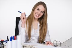 Young woman sits at the desk Stock Photo