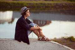 Young woman sits and rests Royalty Free Stock Photo