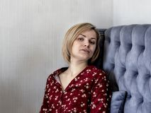 Woman on the couch in the room. stock image