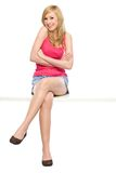 Young woman sitting Stock Photography