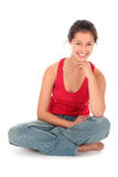 Young woman sitting Stock Image