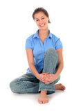 Young woman sitting Stock Photos