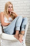Young woman sitting on a armchair. cozy mood Stock Photography