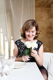 Young woman sitting at the Banquet table with Royalty Free Stock Image
